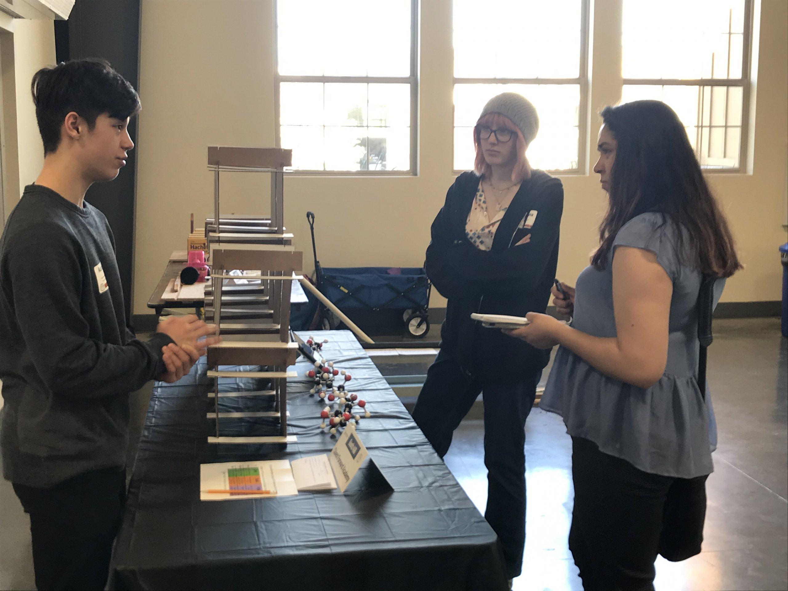 Quest Forward Academy Santa Rosa students Austin and Montana present their work.